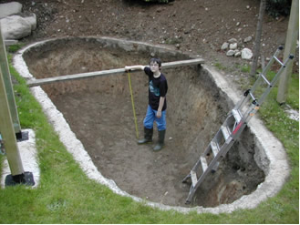 My son Patrick checking the pond depth as we finished the excavation by hand